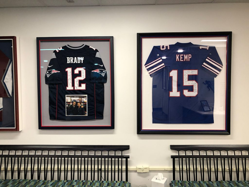 The jerseys of Jack Kemp and Tom Brady, patients at The Steadman Clinic.
